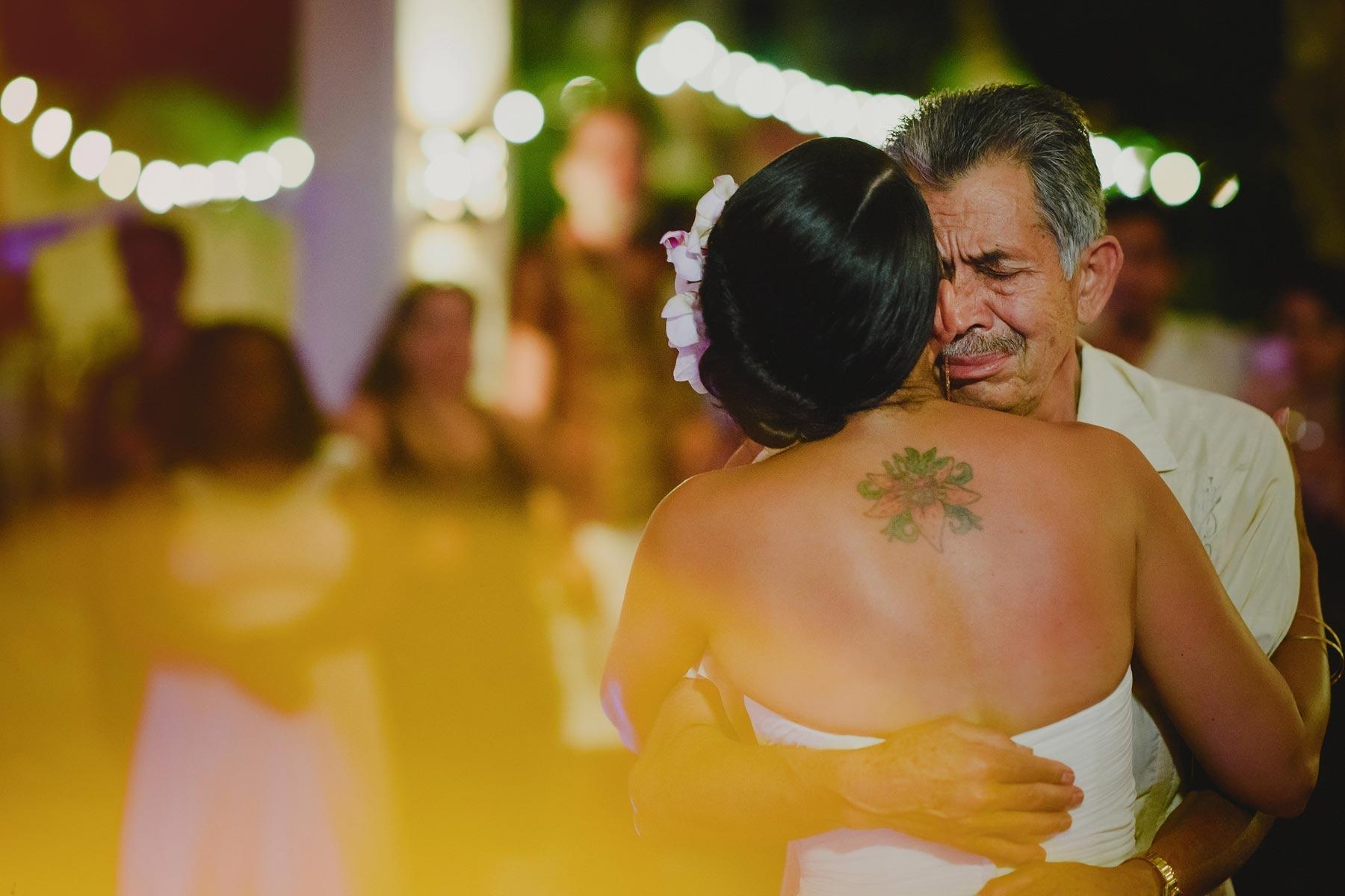 dad holds bride in riviera maya