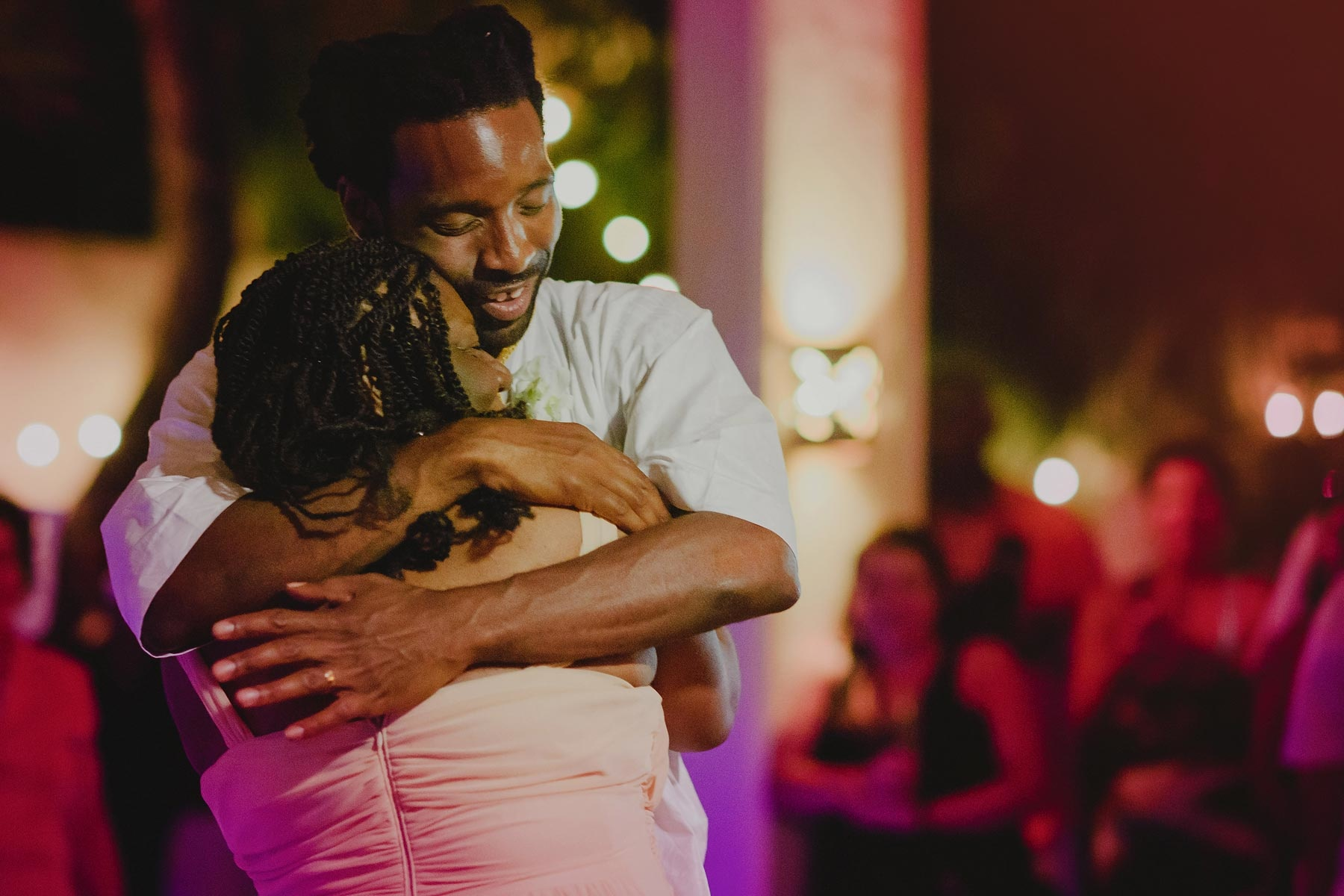 groom holds mom in riviera maya